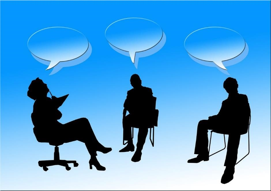 Cartoon image of three people sat in chairs, debating a topic
