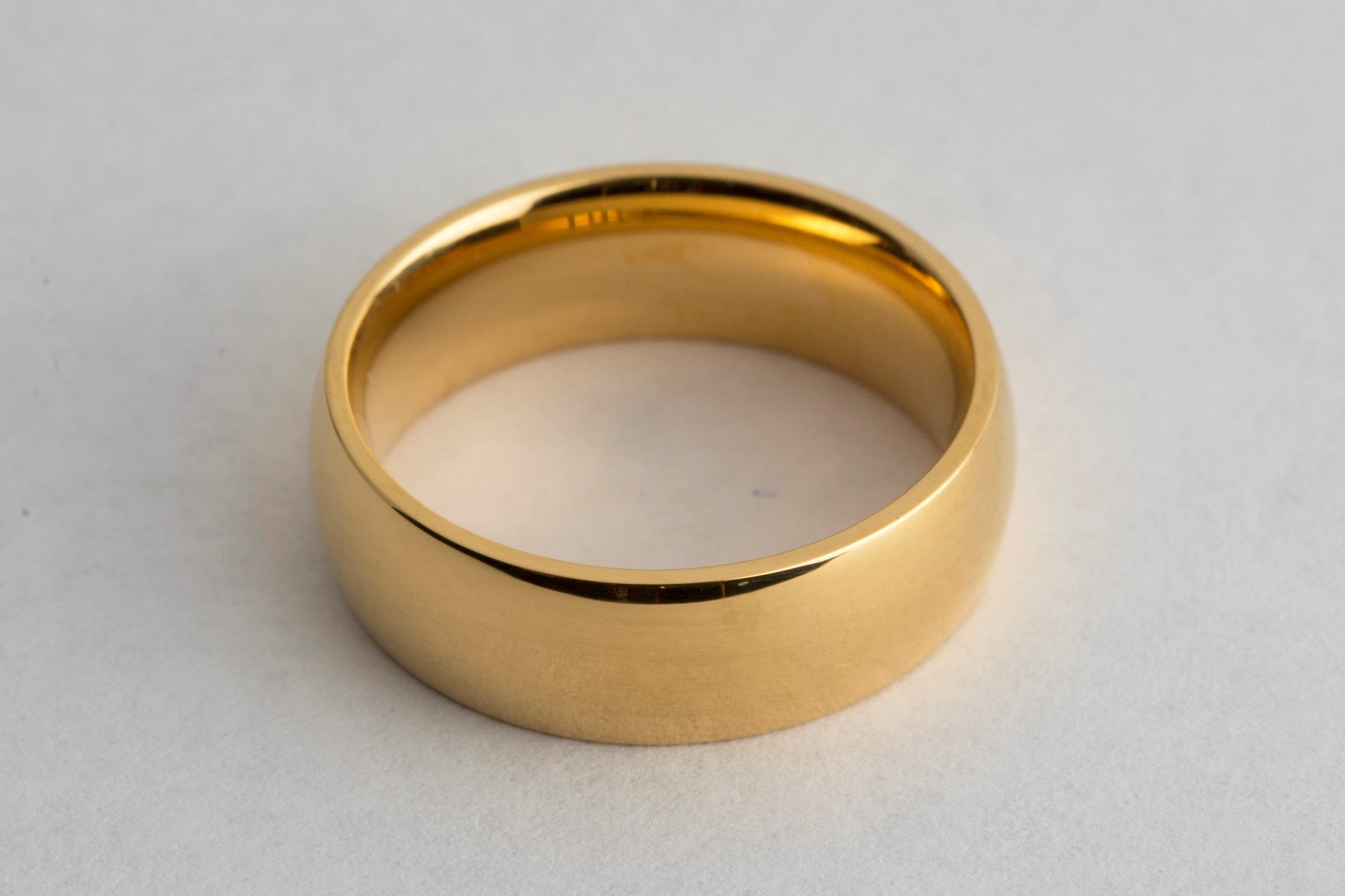Gold wedding ring electroplated in 24k gold solution