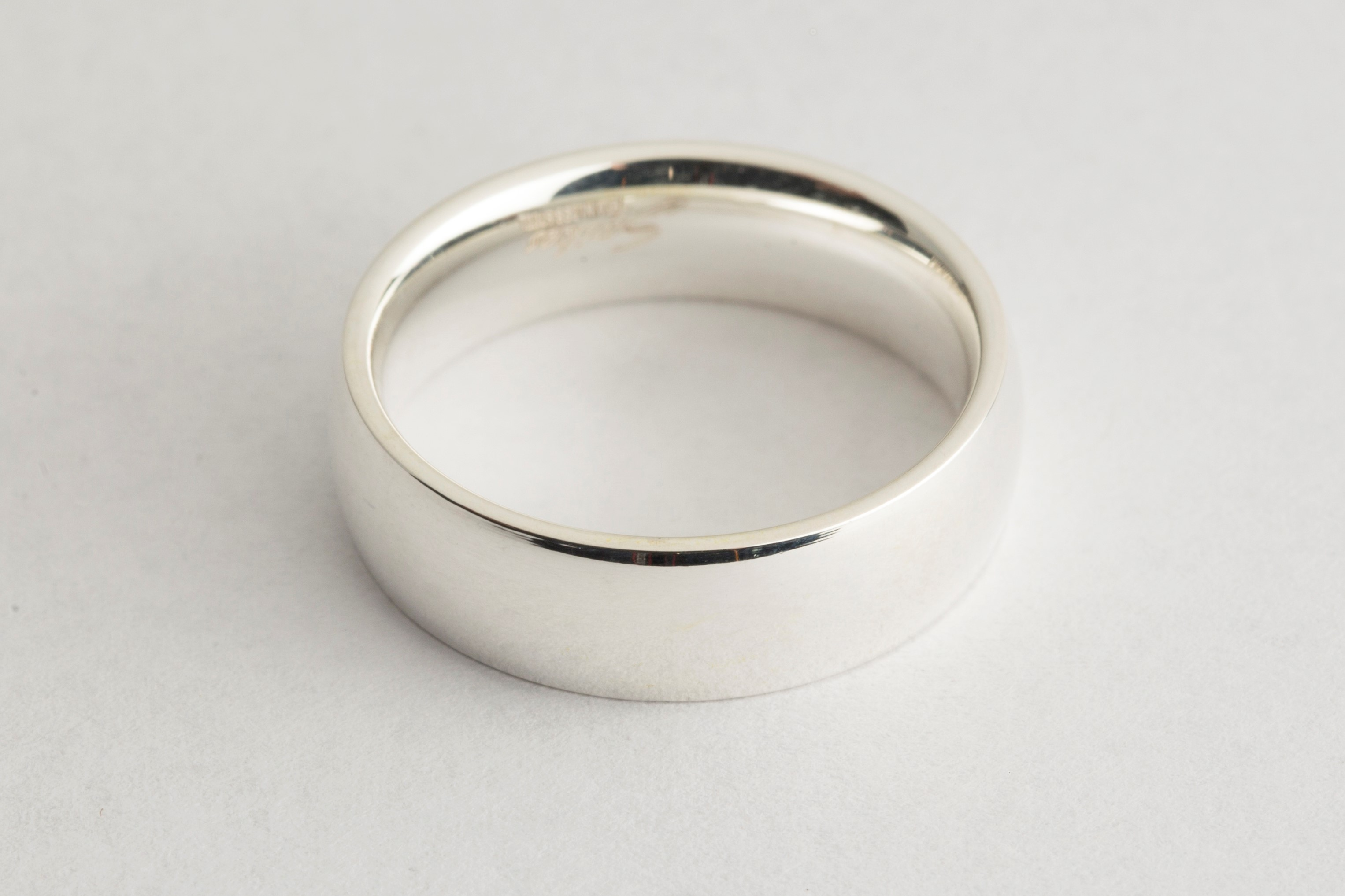 Men's wedding ring electroplated with rhodium solution