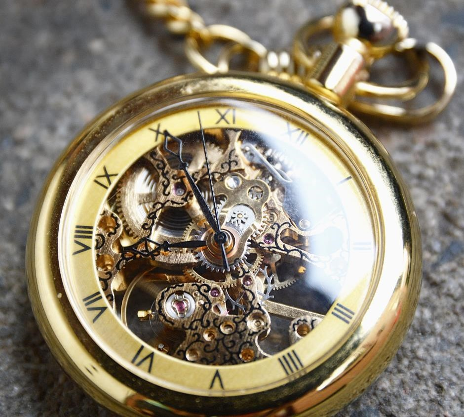 Gold plated antique pocket watch with roman numerals