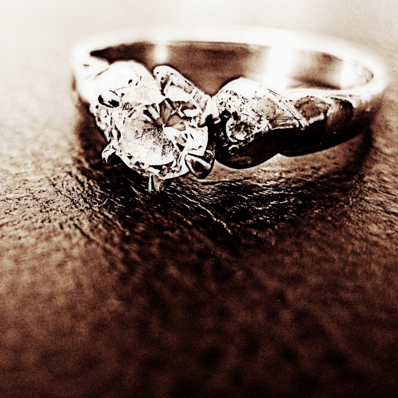 Rhodium plated white gold engagement ring with diamonds