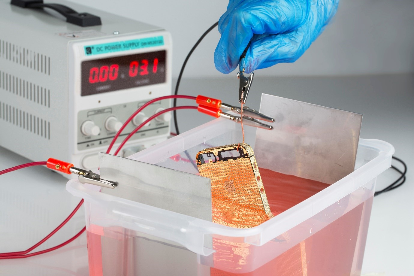 IPhone being gold plated in an electroplating tank