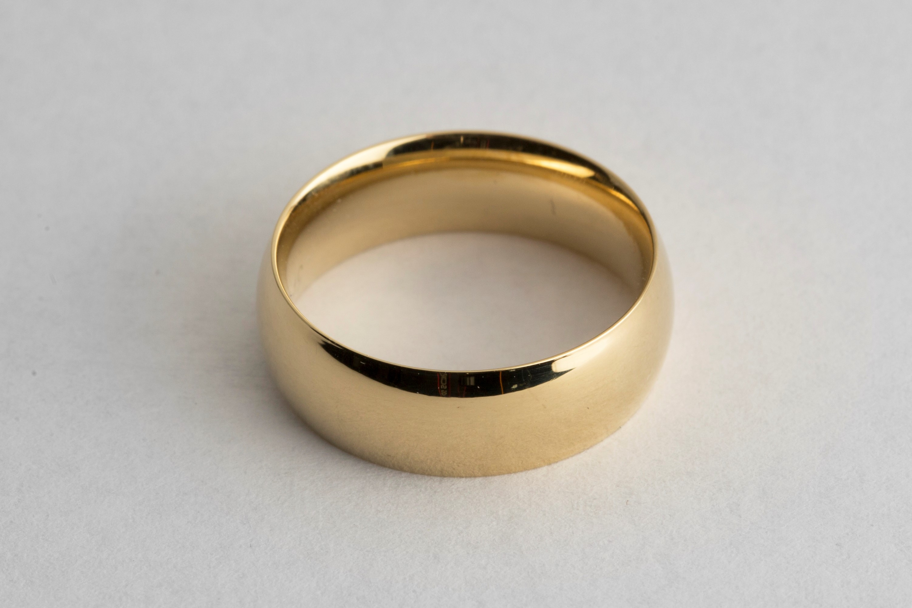 Gold wedding ring electroplated in 18k gold solution