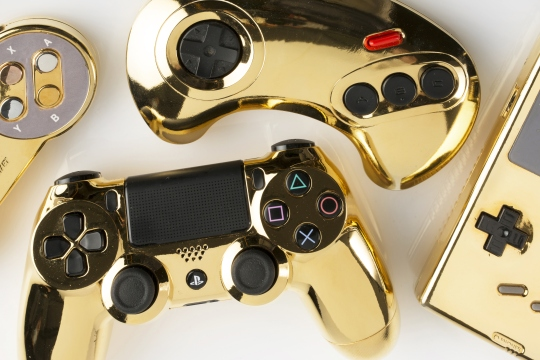 Gold plated Playstation controller, GameBoy and other gaming items